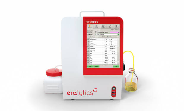 An ERASPEC FTIR fuel analyzer showing the results table summarizing results such as RON, MON, ethanol content, ...