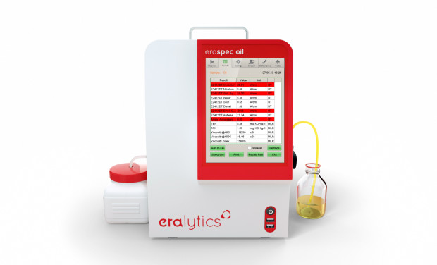 An ERASPEC OIL lube oil analyzer showing the results screen